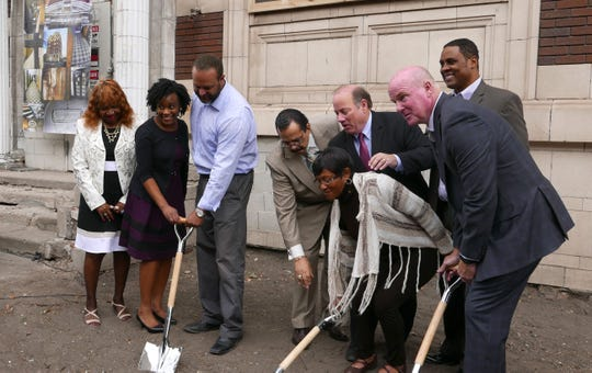 From left, Janice McCrary, CCIH Board of Directors Chairwoman; Tasha Gray, Executive Director of The Homeless Action Network of Detroit; Ryan M. Lepper, CCIH President and CEO; Rev. Jim Holley, Little Rock Baptist Church; Mike Duggan, Mayor; Pam Girton Hart, Employee and Resident of Another CCIH Facility; Curtis Smith, CCIH Chief of Housing and Joe Early, Early Construction during a 2017 ground breaking ceremony for Central City Integrated Health.