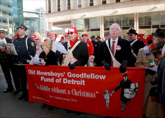 From left, Chief Dale Bradley, Annie Atanian, Dennis Archer and Marshall Hunt. during the 2017 Old Newsboys' Goodfellow Fund of Detroit sales day in downtown Detroit.