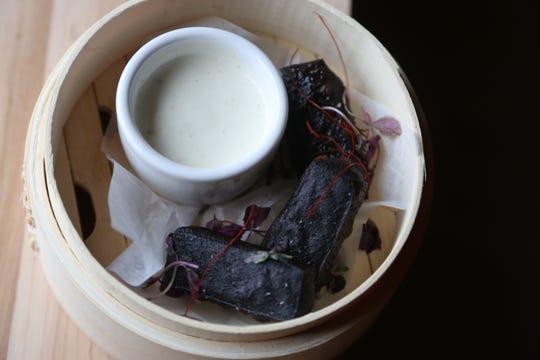 Black garlic chickpea fritters and yuzu whip from Antihero.