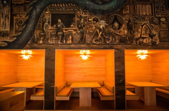 Local artist Glenn Barr contributed murals to the interior of Antihero.