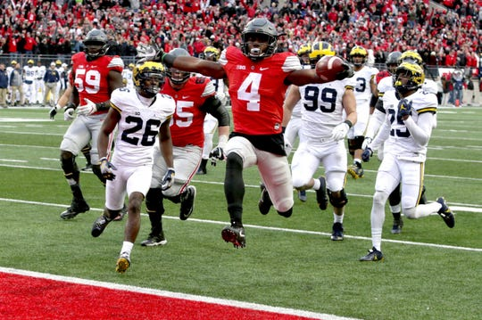 Curtis Samuel leaps into the end zone during the second overtime to give Ohio State a 30-27 win over Michigan in Columbus, Ohio on Nov. 26, 2016.