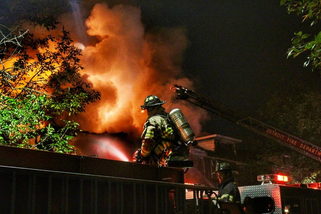 Detroit firefighters battle a fully engulfed structure fire at a vacant home on Savannah Street in October.