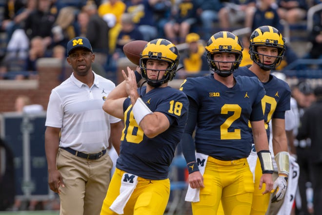 Pep Hamilton keeps an eye on quarterbacks Brandon Peters, Shea Patterson and Dylan McCaffrey before the game against Western Michigan this season.