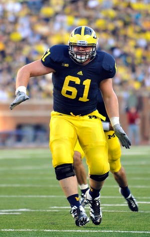 Graham Glasgow, pictured in 2012, lettered at Michigan from 2012-15.
