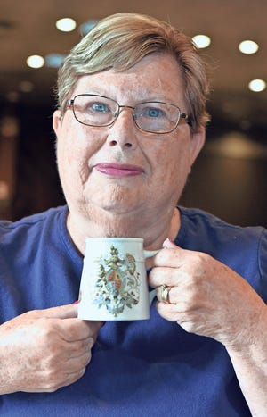 Linda Tucker with the 1897 mug that was given to her grandparents.