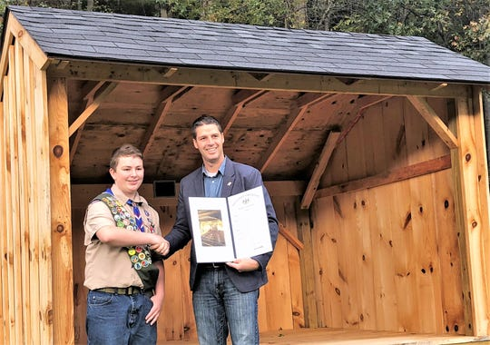 Pennsylvania state Rep. Clint Owlett honors Benjamin Wolf of Mansfield for earning his Eagle Scout award.