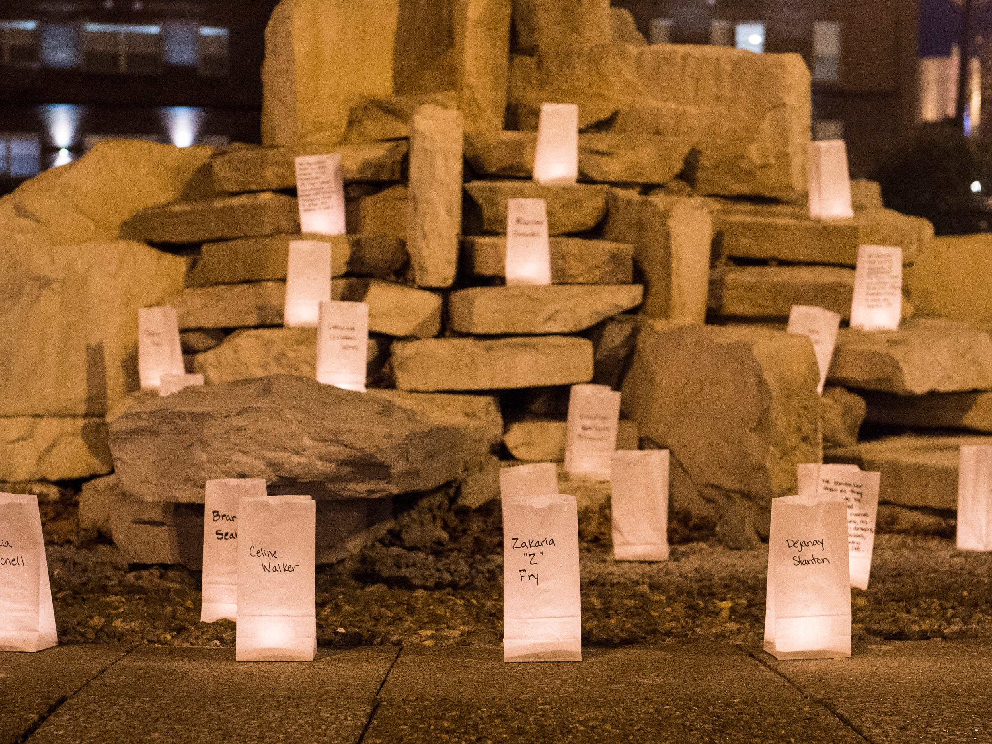 Bags line the fountain at Haynie's Corner to honor those who died by violence in 2018 during the Transgender day of Remembrance candlelight vigil hosted by local support group Gender Warriors  Tuesday, Nov. 20, 2018.