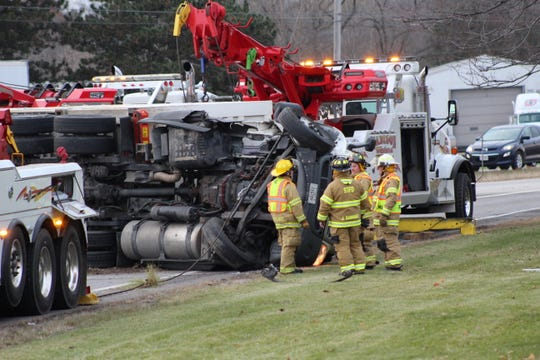 Wreckers attempt to flip over an overturned semi on U.S. 20.