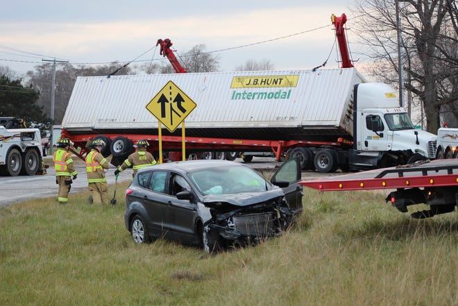 A semi was overturned after a Ford SUV crashed into it along westbound U.S. 20.