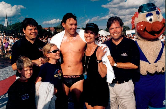 Paul Asmuth in 2004 when he swam in the 50th Anniversary of Lac St. Jean, a 21-mile race in very cold water. With him are daughter Kendall and son Logan and  wife Marilyn.