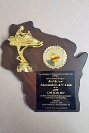 Red Arrow Snowmobile ATV Club in Townsend received this plaque for Snowmobile Club of the Year on Oct. 27 from the Association of Wisconsin Snowmobile Clubs.