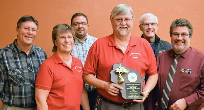 Members of the Red Arrow Snowmobile ATV Club in Townsend were presented with the Snowmobile Club of the Year Award by the Association of Wisconsin Association of Snowmobile Clubs on Oct. 27. From left are club board members Dennis Pommering, Sandy Wagner, Mike Ott, president Gary Wagner holding the award, John Brantmeier and Jeff Schwaller, the Marinette County AWSC Director who was chairperson of AWSC's selection committeee.