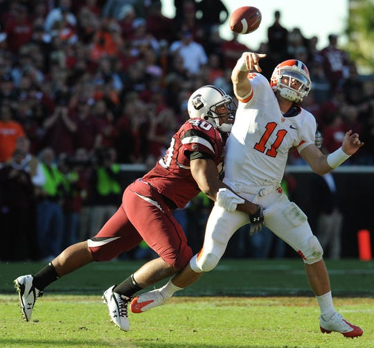 Clemson quarterback Kyle Parker (11) is pressured by South Carolina linebacker Eric Norwood (40) during the fourth quarter Saturday, November 28, 2009 at Carolina's Williams Brice Stadium in Columbia.