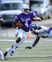 Furman quarterback Darren Grainger (4) picks up yards against Samford Saturday, October 20, 2018, at Paladin Stadium.