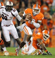 Clemson quarterback Tajh Boyd (10) carries for a 1st down against South Carolina during the 1st quarter Saturday, November 24, 2012 at Clemson's Memorial Stadium.
