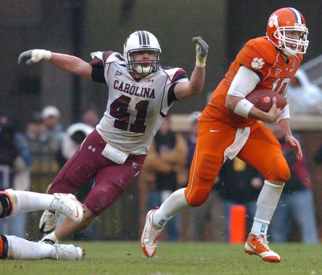 Clemson quarterback Cullen Harper (10) carries for 6 yards past South Carolina's Jordin Lindsey (41) during the 3rd quarter Saturday, November 29, 2008 at Clemson's Memorial Stadium.