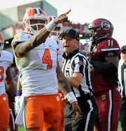 Clemson quarterback Deshaun Watson points to the Clemson fans after scoring his 3rd TD of the game against South Carolina in the 4th quarter Saturday, November 28, 2015 at Carolina's Williams Brice Stadium.