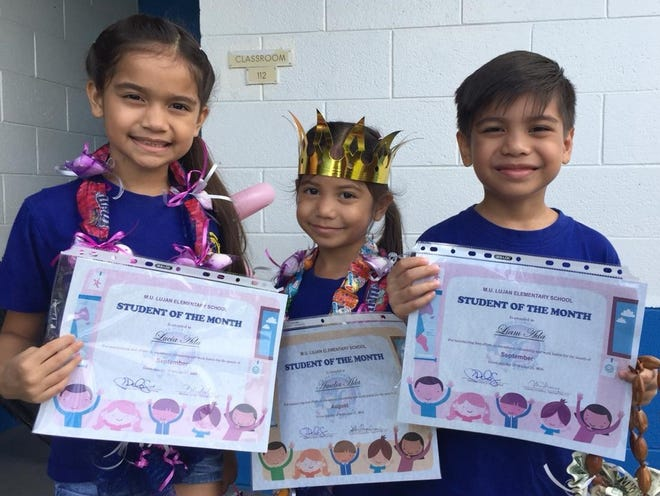 """The Ada siblings attending M.U. Lujan Elementary School in Yona were awarded Student of the Month during assembly on Oct. 15. Pictured From left: Lucia Rene Sablan Ada (3rd grade), Amelia Jane Sablan Ada (Kinder), and Liam Antonio Sablan Ada (1st grade).  Parents are Janice and Anthony """"TJ""""."""