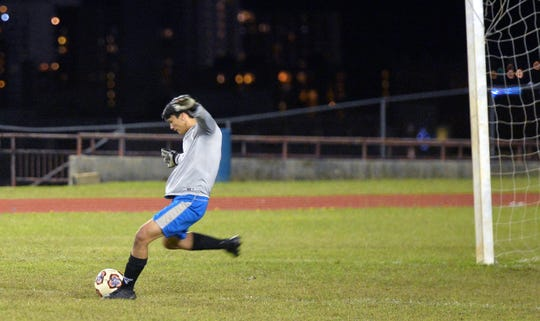 St. John's Knights goalie Alexander Stenson clears the ball on a goalie kick in their IIAAG Boys Soccer match against the JFK Islanders Nov. 20 at Ramsey Field. JFK won 4-1.