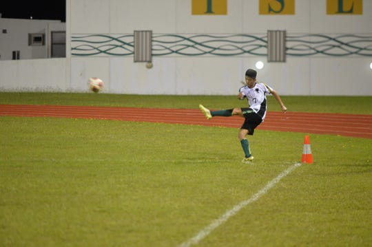 JFK's Eddie Cho nails a corner kick against St. John's late in their IIAAG Boys Soccer match Nov. 20 at JFK. The Islanders won 4-1; Cho scored JFK's first goal in the first half.