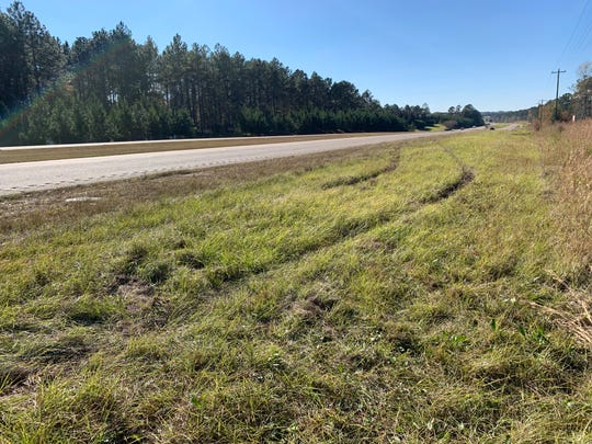 Skid marks remain in the grass at the site where cyclist James Dobson was killed Tuesday, Nov. 13, 2018, on U.S. 98 in Lamar County, Mississippi.