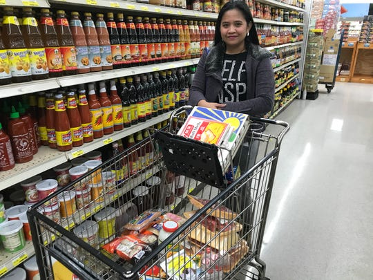 Cecelia Rodriguez loaded her cart at Saraga International Grocery with ingredients for a Filipino Thanksgiving meal.
