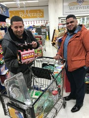 Edelfi Gavin and Wilberto Gonzalez are making a Caribbean Thanksgiving for 45 guests in Fort Wayne, and found their ingredients Nov. 21 at Saraga International Grocery in Indianapolis.