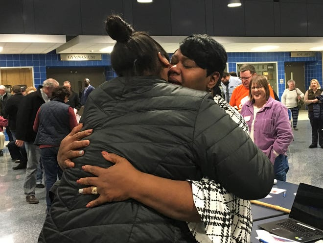 Royceann Porter in an embrace after being named the Democratic Party of Johnson County's nominee for the Special Election to fill a vacancy on the Board of Supervisors at Clear Creek Amana High School on November, 20 2018.