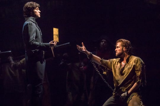 "Josh Davis, left, as Javert and Nick Cartell, right, as Jean Valjean in ""Les Miserables."" Photo by Matthew Murphy."
