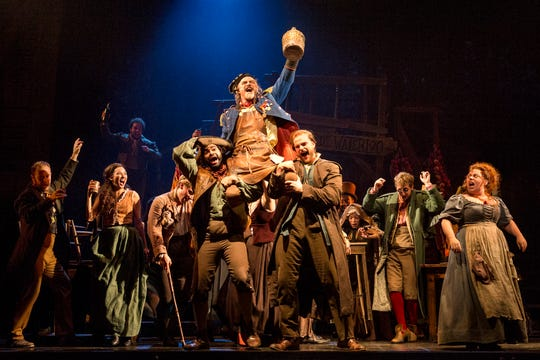 """Cast members of """"Les Miserables"""" hold up Anthony Crane, who plays Thenardier. Photo by Matthew Murphy."""