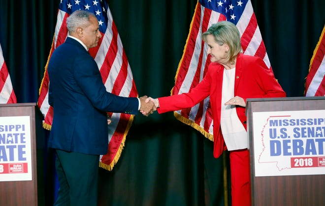 U.S. Sen. Cindy Hyde-Smith and Democrat Mike Espy greet each other before a televised debate in 2018. It does not appear the two will debate before their Nov. 3 rematch after Hyde-Smith has declined invitations.