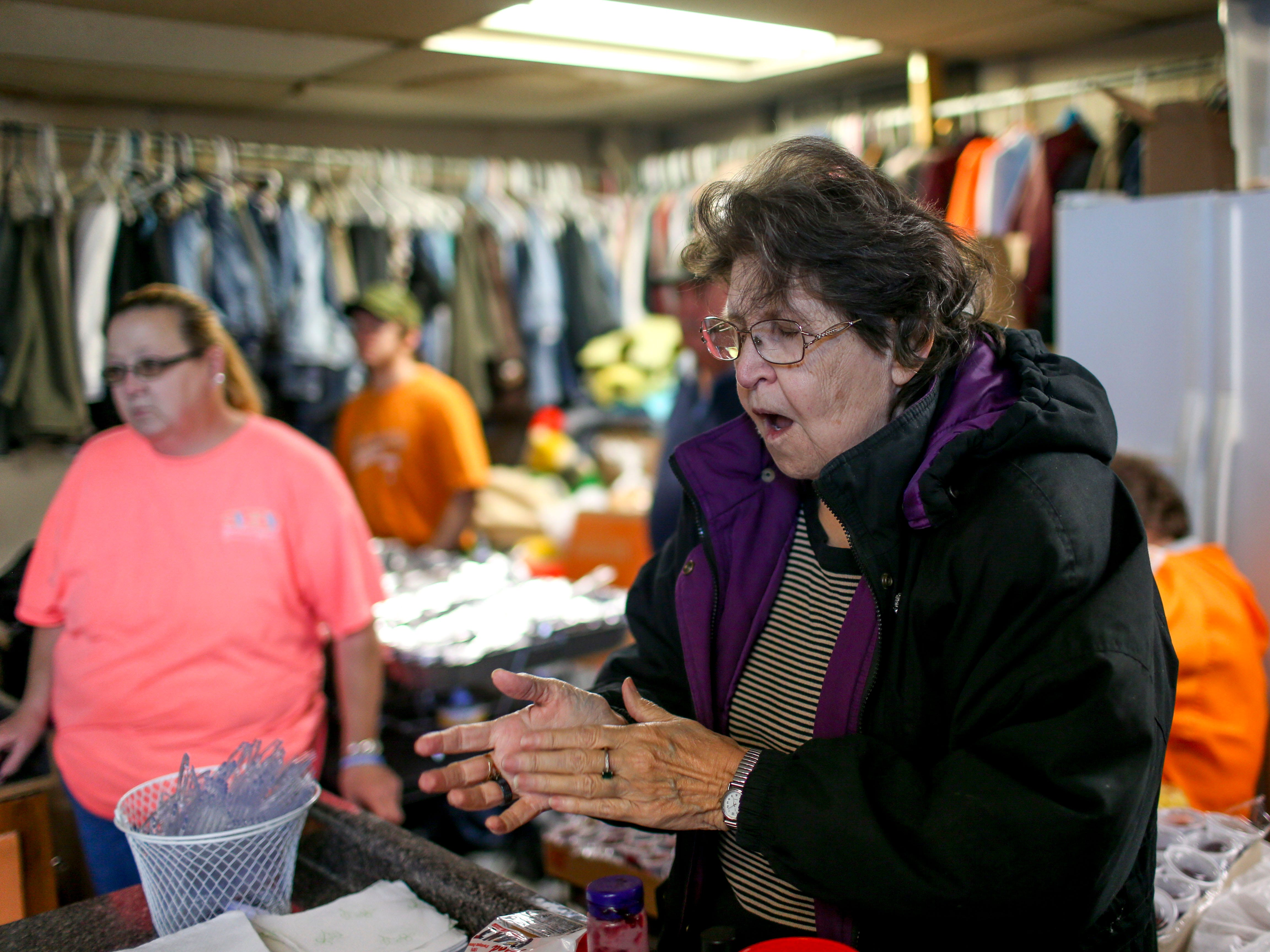 Judith Hindman claps while singing songs of praise at the annual Thanksgiving meal put on by Safe Harbor Day Mission in Jackson, Tenn., on Wednesday, Nov. 21, 2018.