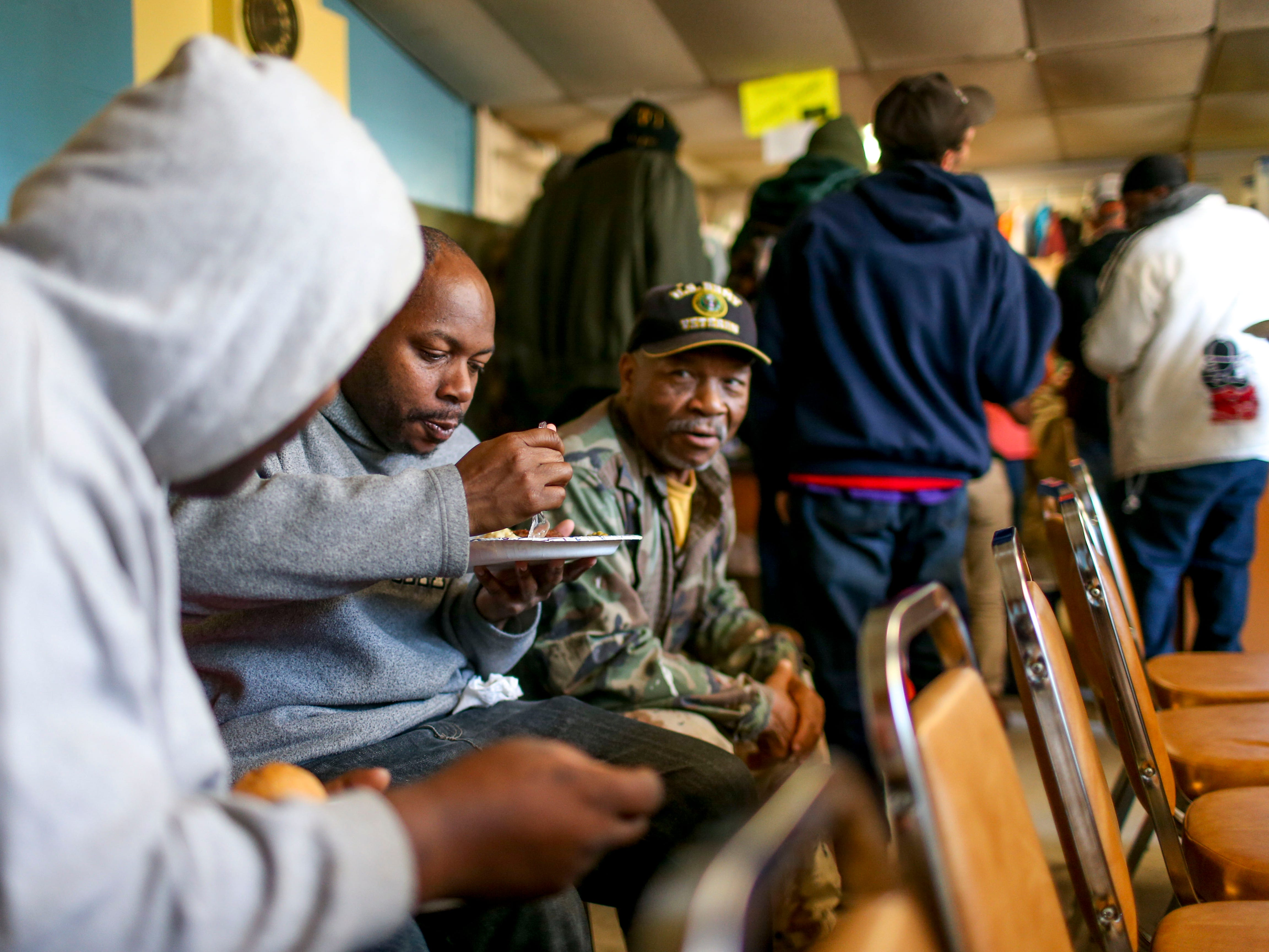 Visitors to the soup kitchen joke around with one another while eating a hot meal at the annual Thanksgiving meal put on by Safe Harbor Day Mission in Jackson, Tenn., on Wednesday, Nov. 21, 2018.