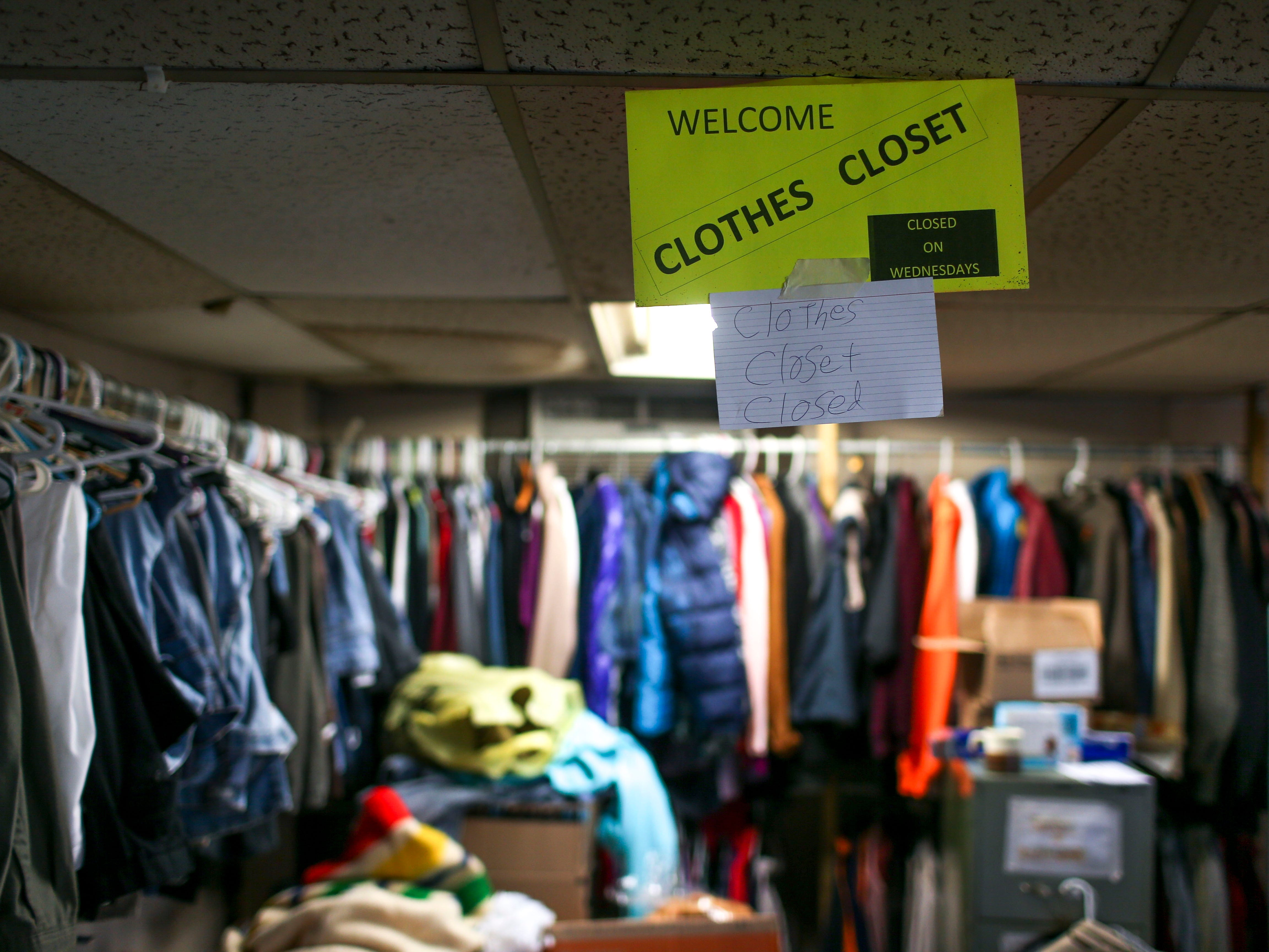 Spare clothing donated for those in need hang on racks in a back corner at the annual Thanksgiving meal put on by Safe Harbor Day Mission in Jackson, Tenn., on Wednesday, Nov. 21, 2018.