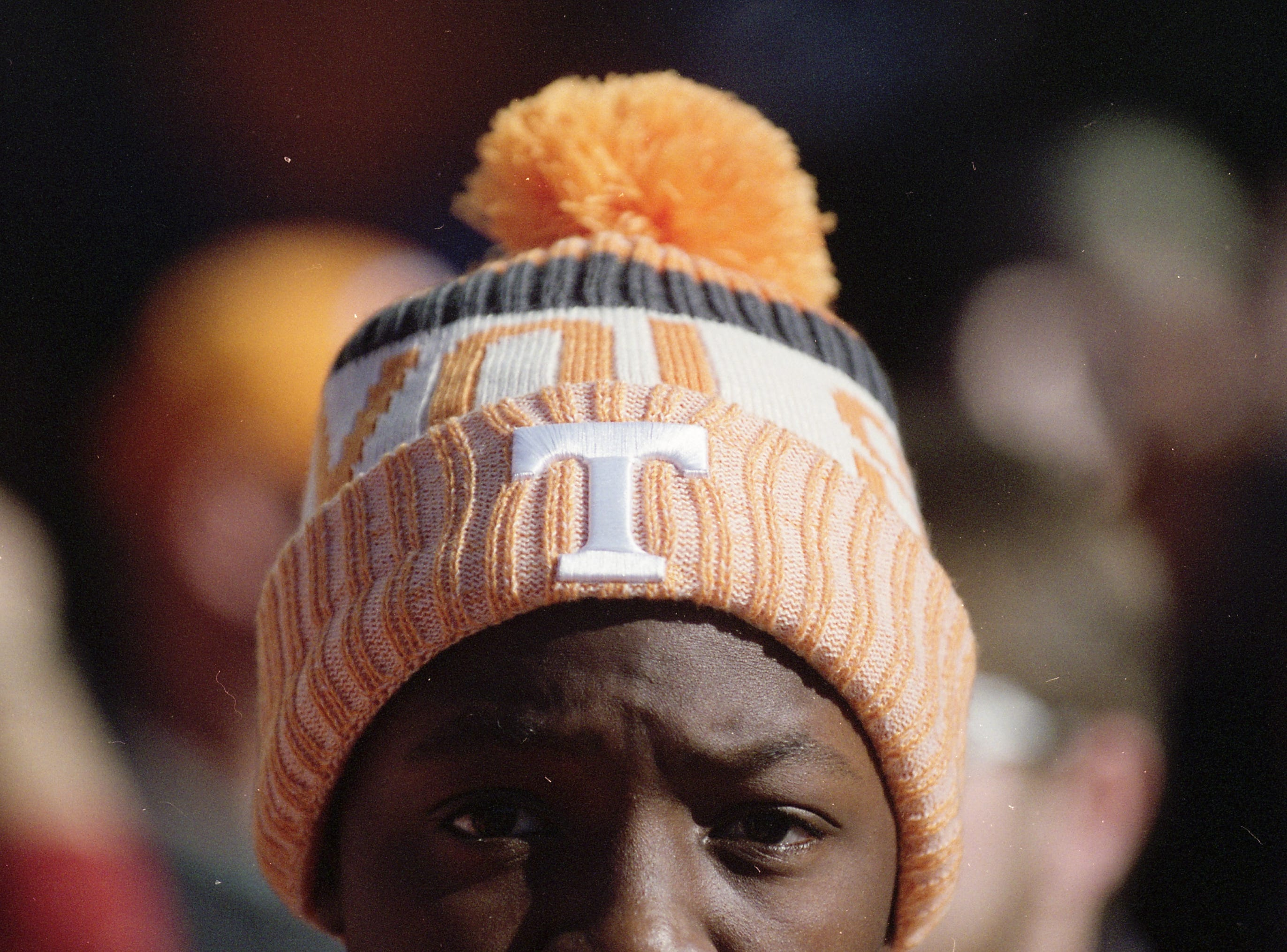 A Tennessee fan stays warm with a hat during the Vol Walk during a game between Tennessee and Missouri at Neyland Stadium in Knoxville, Tennessee on Saturday, November 17, 2018.