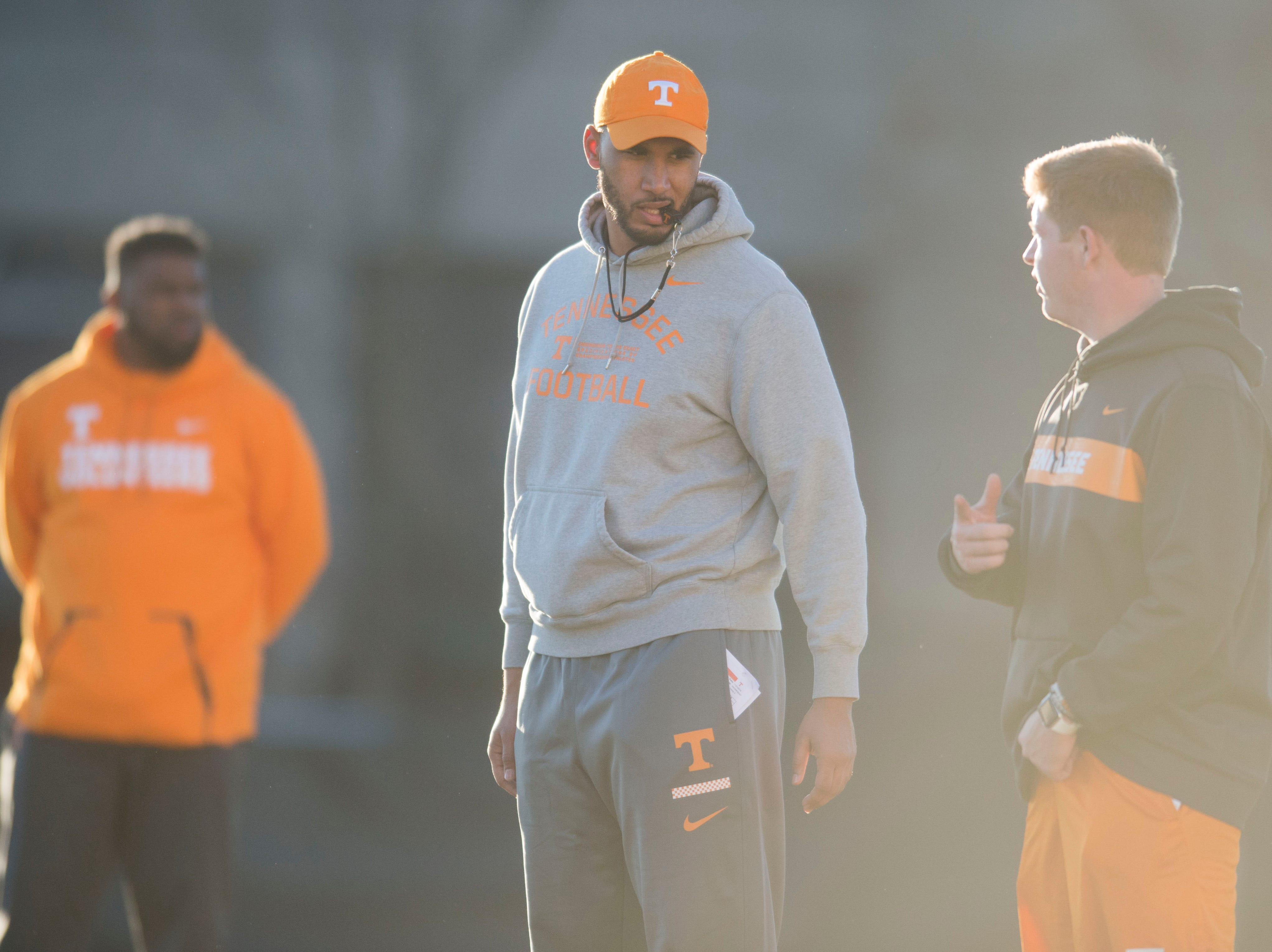 Offensive grad assistant Cameron Clemmons assists during Vols football practice Wednesday, Nov. 21, 2018.