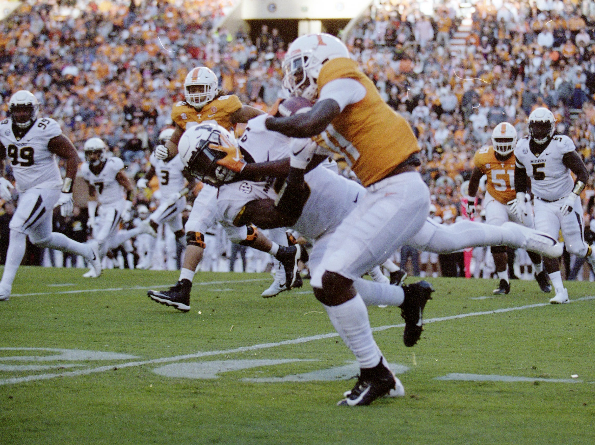 Tennessee wide receiver Jordan Murphy (11) pushes away A Missouri defender during a game between Tennessee and Missouri at Neyland Stadium in Knoxville, Tennessee on Saturday, November 17, 2018.