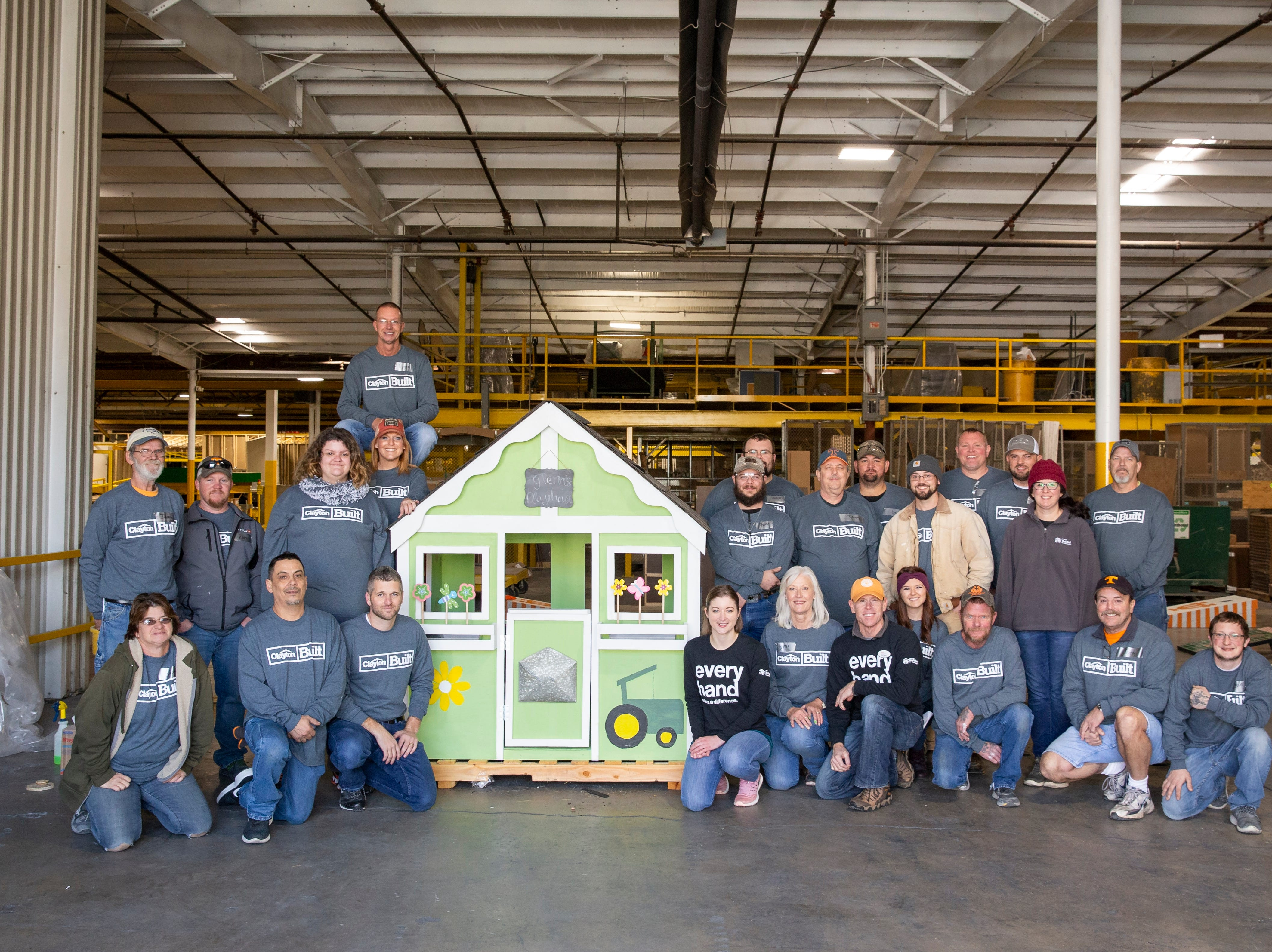 TRU Halls Team Members with Habitat for Humanity pictured here on Nov. 17 with the first completed Project Playhouse in Knoxville.