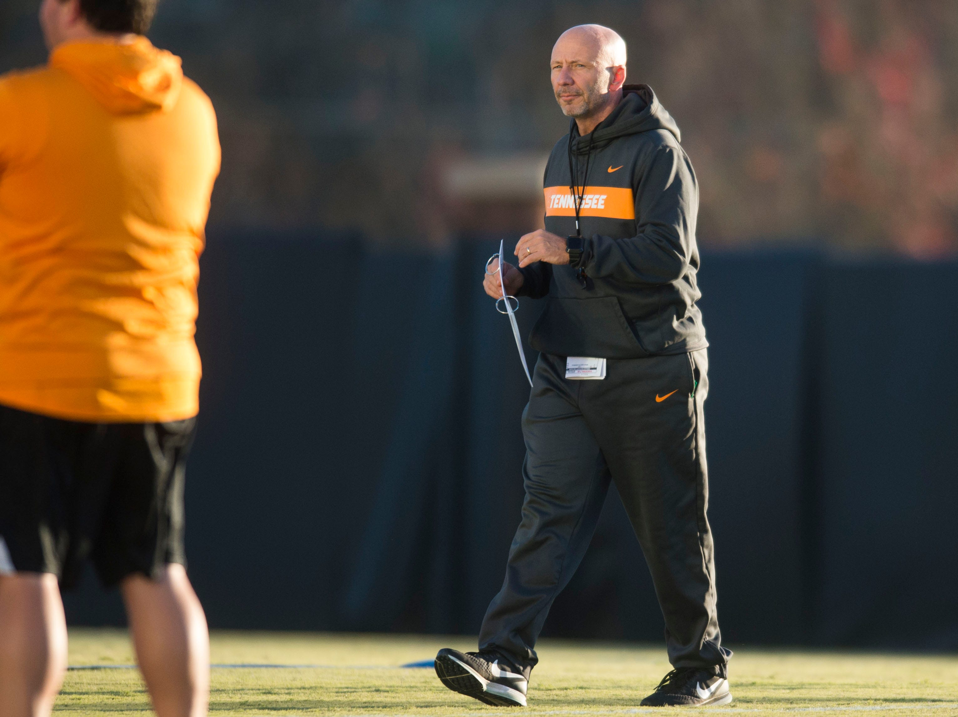 Special teams coordinator and safeties coach Charles Kelly walks on the field during Vols football practice Wednesday, Nov. 21, 2018.