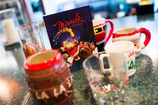 Christmas mugs and glasses sit on the bar at Sapphire on Gay Street on Nov. 21, 2018. Sapphire is transforming into a Christmas pop-up bar from Black Friday until Dec. 30.