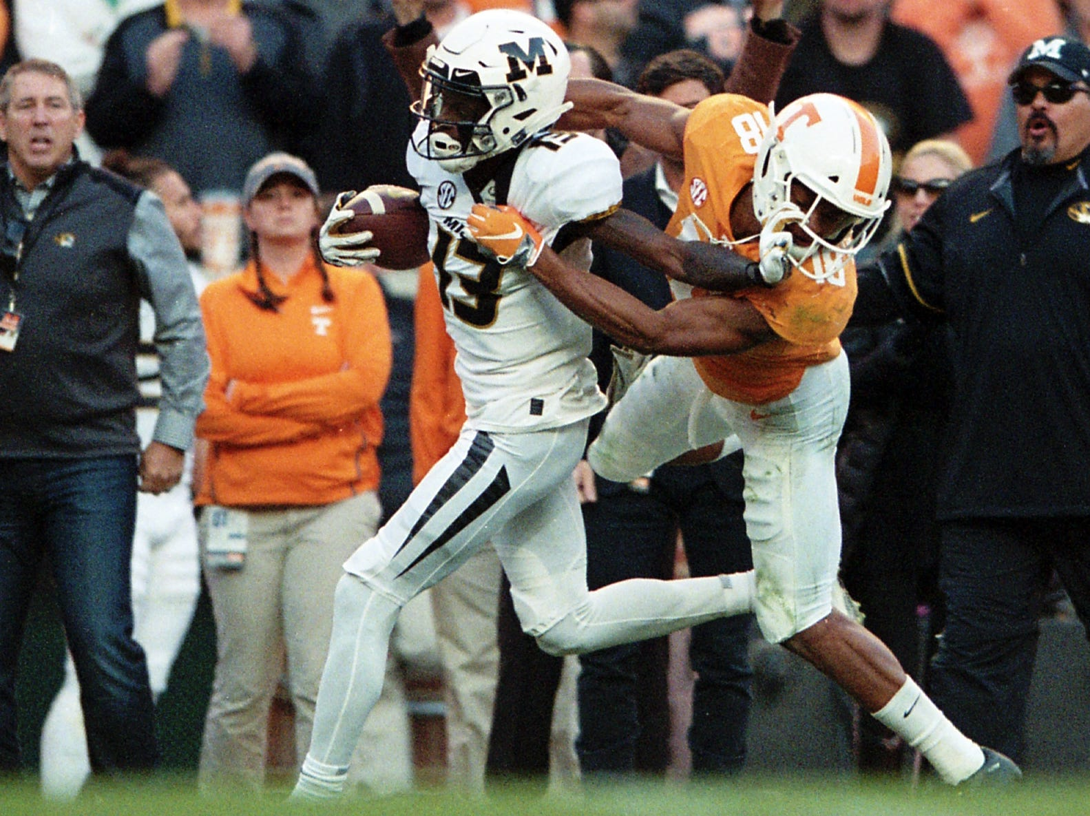 Tennessee defensive back Nigel Warrior (18) tries to tackle Missouri wide receiver Kam Scott (13) as he runs the ball down the sideline during a game between Tennessee and Missouri at Neyland Stadium in Knoxville, Tennessee on  Saturday, November 17, 2018.