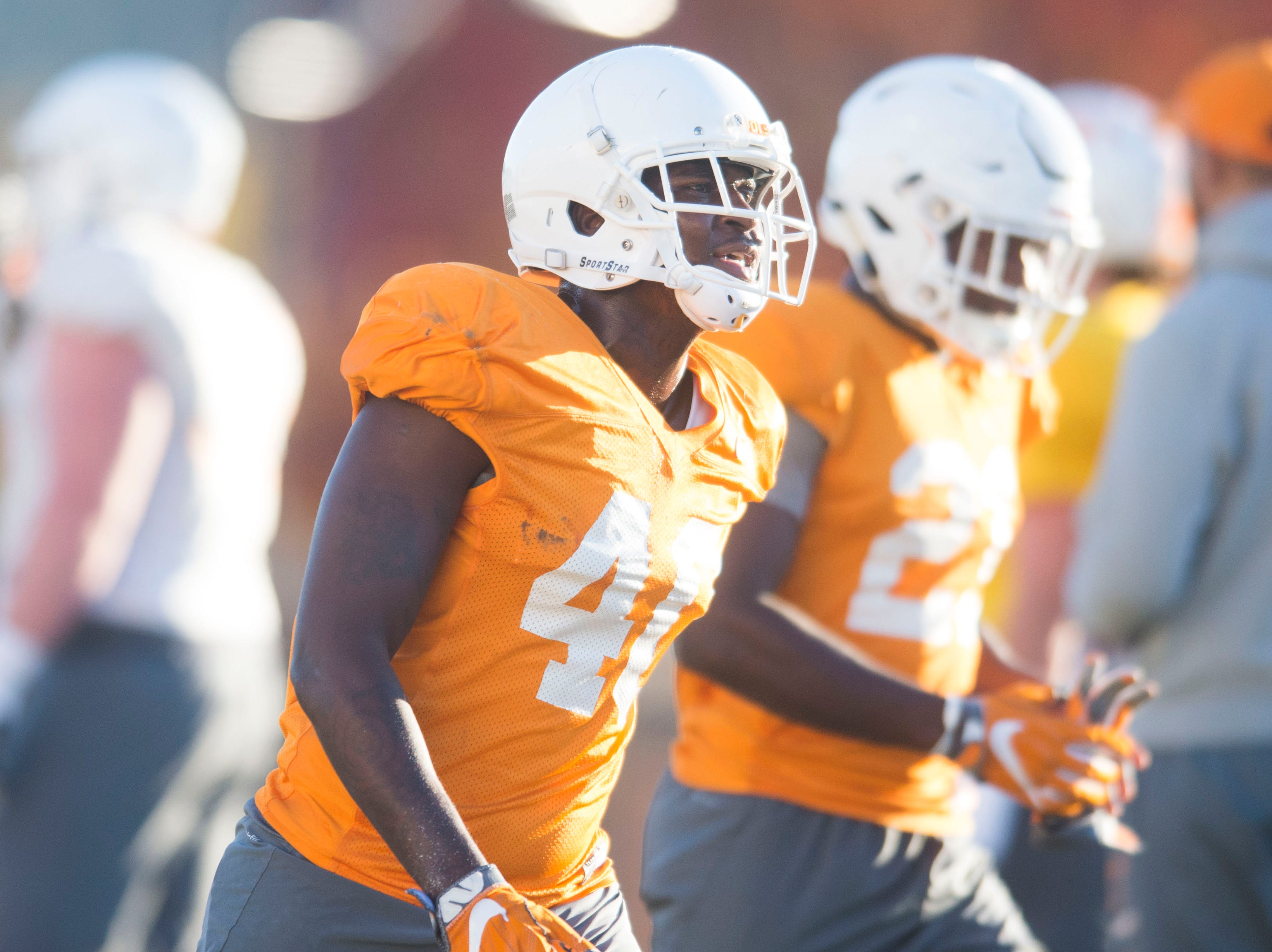 Tennessee players run on the field during Vols football practice Wednesday, Nov. 21, 2018.