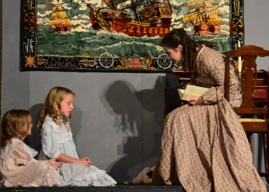 """Minnie and Kitty Kirke (Marrett Beckler and Maizee Beckler) are tutored by Jo (Jordan Parker) while she is on a quest for independence in New York, in a scene from """"Little Women"""" at Hardin Valley Academy on Sunday, Nov. 18."""