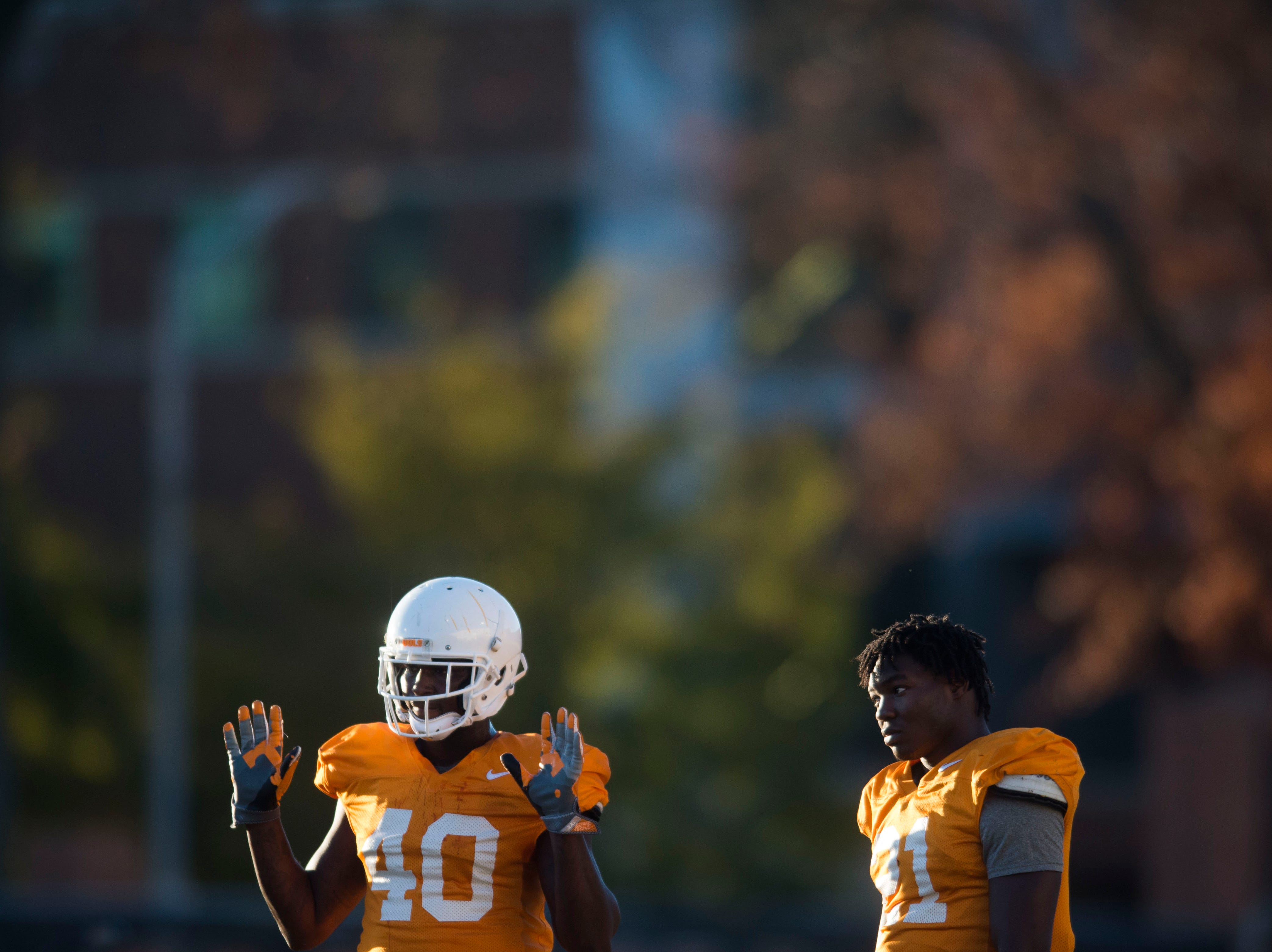 Tennessee linebacker JJ Peterson (40) and Tennessee linebacker Shanon Reid (21) stand on the field during Vols football practice Wednesday, Nov. 21, 2018.