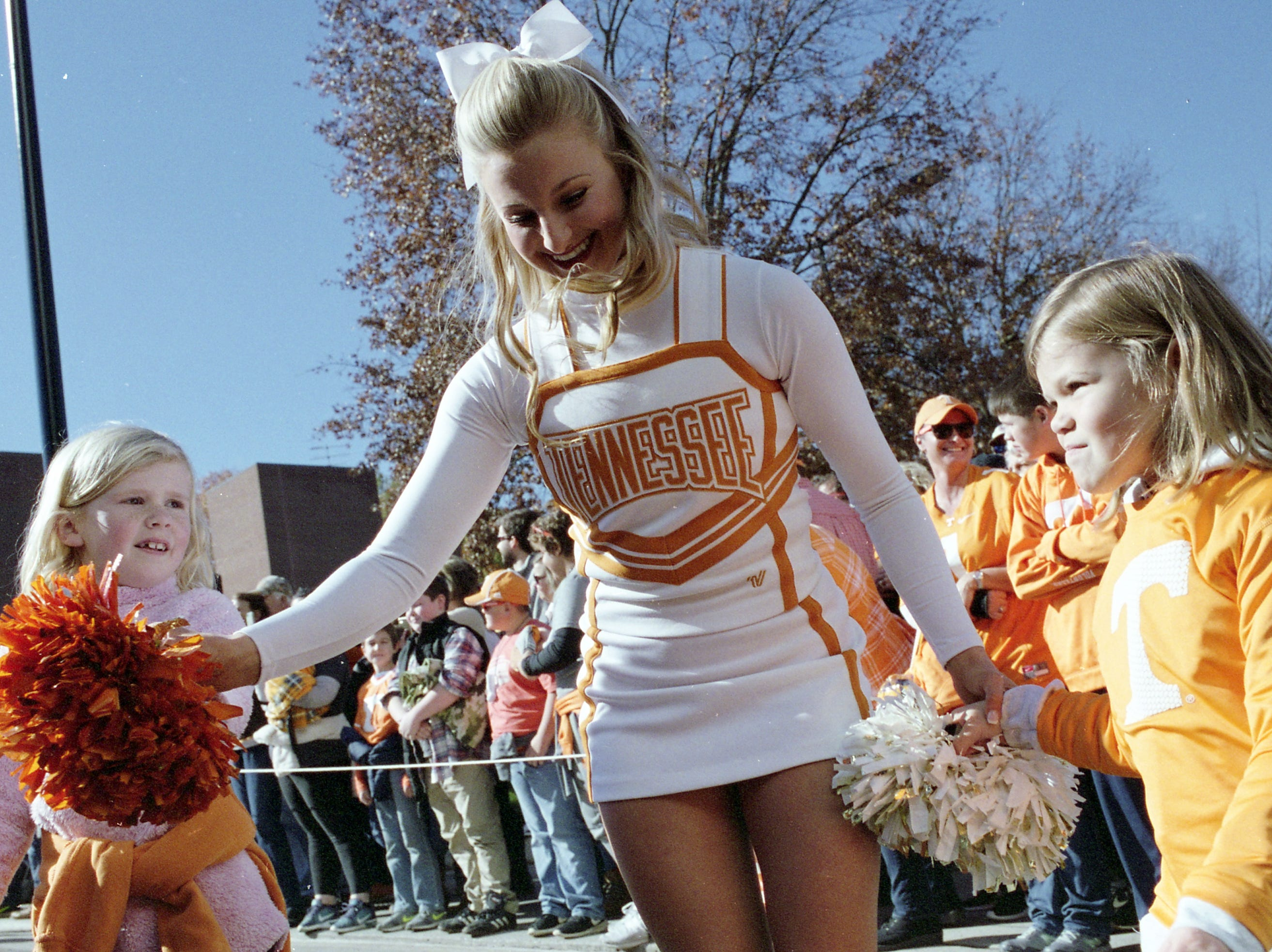 A UT cheerleader teaches kids how to cheer during a game between Tennessee and Missouri at Neyland Stadium in Knoxville, Tennessee on Saturday, November 17, 2018.