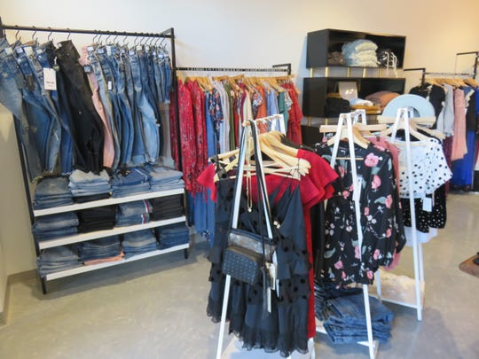 Racks of clothes are shown inside the Elyse Wilde women's boutique in Bearden.