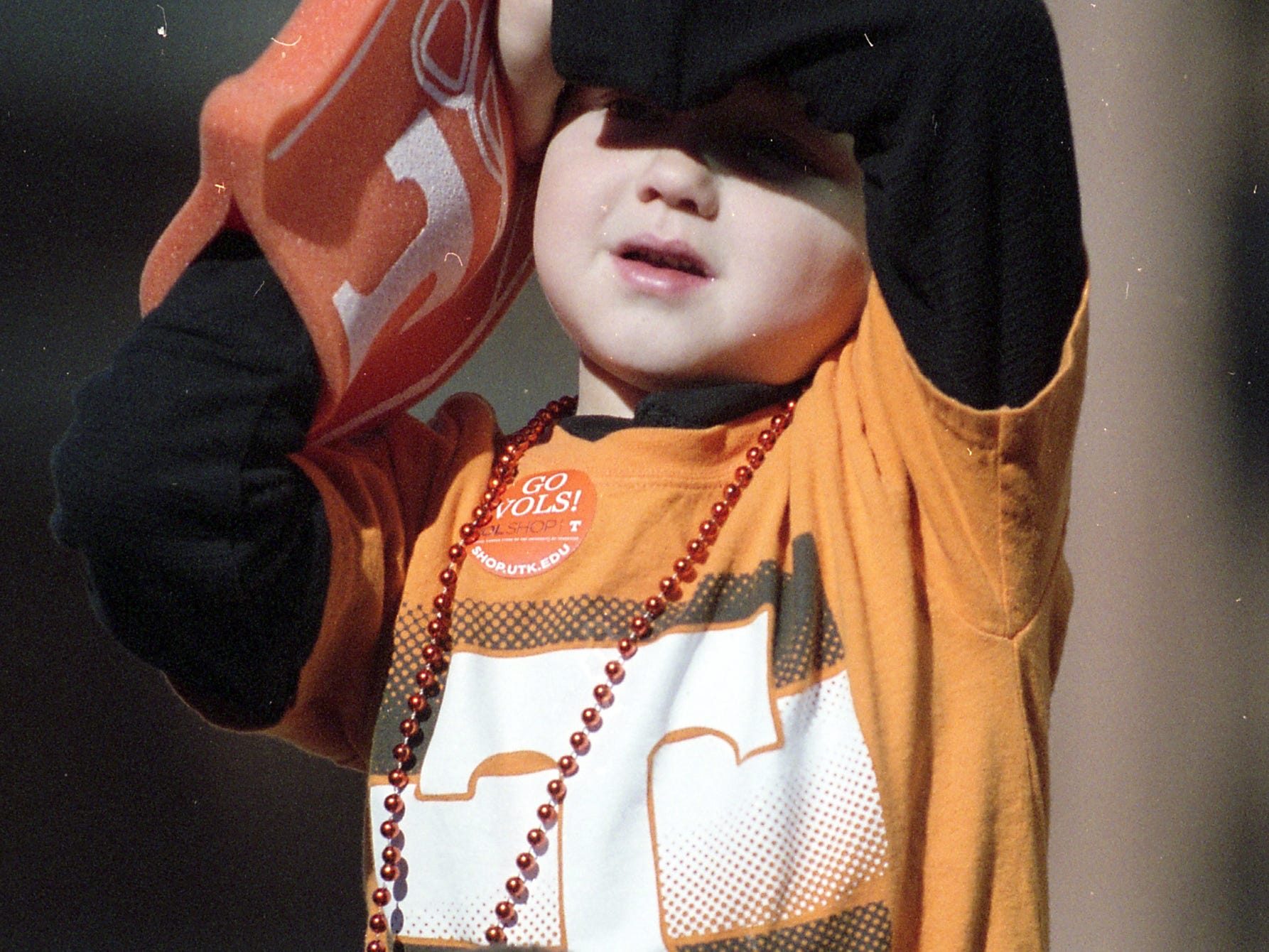 A young Vol fan gets a better view from the shoulders of a loved one during a game between Tennessee and Missouri at Neyland Stadium in Knoxville, Tennessee on Saturday, November 17, 2018.