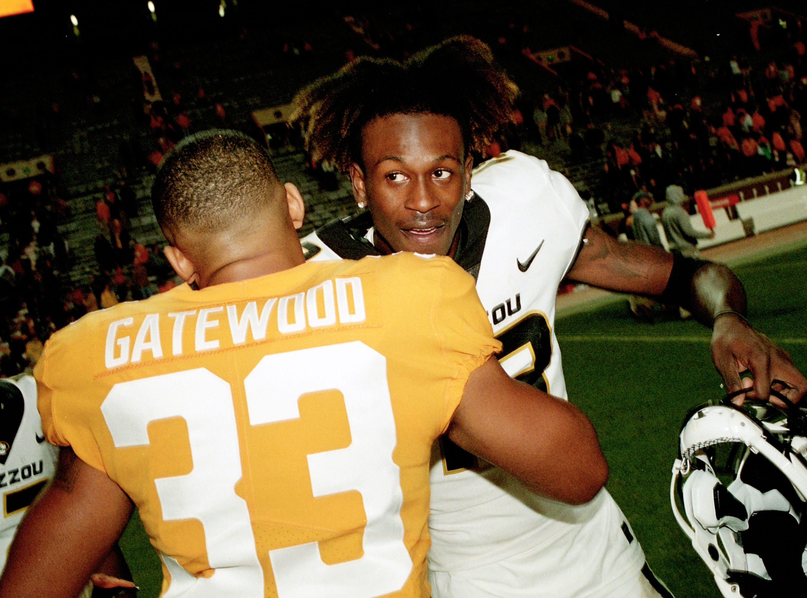Missouri wide receiver Kam Scott (13) hugs Tennessee defensive back MaLeik Gatewood (33) during a game between Tennessee and Missouri at Neyland Stadium in Knoxville, Tennessee on Saturday, November 17, 2018.