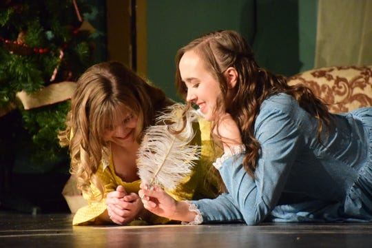 """Amy (Alex Miller) and Beth (Tori Hart) settle onto the floor to put pen to paper during """"Little Women,"""" a Hardin Valley Academy production, Sunday, Nov. 18."""