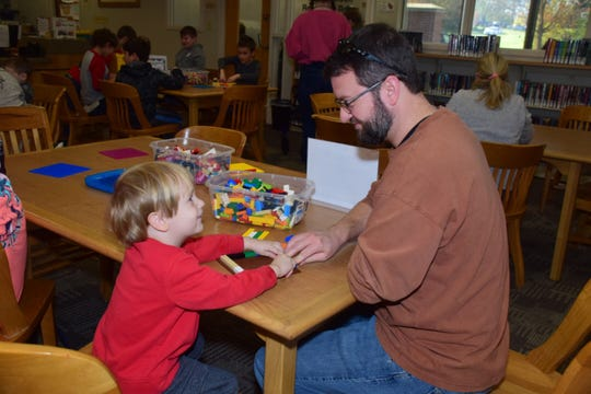 Samuel Lowe, 3, and dad Jeff Lowe share father-son time together at the LEGO Club held at Karns Branch Library Saturday, Nov. 17.